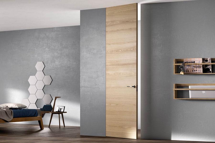 Le porte in legno di ferrero legno mam ceramiche for Porta filo muro grezza